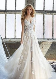 Mori Lee Bridal Kennedy 8206 is a Slim A-Line Wedding Dress Featuring an Elaborately Beaded and Embroidered V-Neck Bodice with Appliqués on English Net. Find Affordable and Exceptional Mori Lee Wedding Dresses at Ginnys Bridal Collection. Wedding Dinner Dress, Boho Wedding Dress With Sleeves, Wedding Dress Trends, Perfect Wedding Dress, Bridal Wedding Dresses, Dream Wedding Dresses, Bridesmaid Dresses, Mori Lee Wedding Dresses, Vintage Inspired Wedding Dresses
