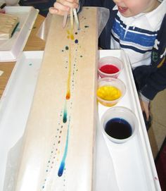 "traveling colors: Kids loved this. The wax paper causes the drops to flow quickly. One child asked if the paper was making ""the water go fast. He removed wax paper from one ramp and.well try it for yourself Preschool Colors, Preschool Science, Science Classroom, Craft Activities For Kids, Science For Kids, Science Activities, Science Projects, Art For Kids, Preschool Ideas"