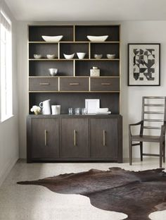 Make the most of your dining storage with this modern, multi-functional buffet and hutch. This set includes three doors with two adjustable shelves behind each door for ample storage space that can be used for dining serving essentials. The open shelf provides additional display space for everything from fine china to decorative accents.