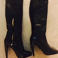 Over the knee boots Nine West over the knee boots. Very stylish and comfy. I'm 5'7 and they are over the knee on me. They are leather with a stretchy piece on the calf which allows larger calf wear. GUC. Nine West Shoes Over the Knee Boots