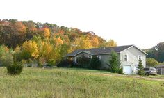 Kennel property for sale, 20 acres with house, out-buildings, kennel buildings and pond, Boyceville WI