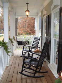 Rocking chairs add simplicity and nostalgia to this porch, urging you to sit down and enjoy the autumn weather. Fall colors are brought in with seasonal plants, while extra comfort is added with a simple white porch swing. Decorative pillows add the final touch to this cozy porch, inviting you to take a minute to relax.