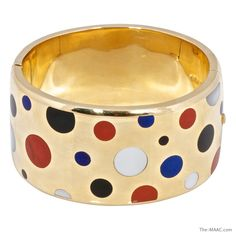 """Very on Trend: Tiffany & Co Allures Collections 18K gold inlaid bangle bracelet.  18K gold lapis, mother of pear, jasper, black jade.  United States, c. 1980s.    Size: 1.5"""" wide"""