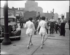 Two women wearing shorts in public for the first time, draw male attention and cause a car accident! Toronto, 1937. @historylvrsclub