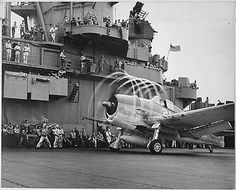 """F6F landing on aircraft carrier USS Yorktown, WWII, USA... """"Dynamic static. The motion of its props causes an """"aura"""" to form around this F6F on U.S.S. Yorktown. Rapid changes of pressure and drop in temperature create condensation. Rotating with blades, halo moves aft, giving depth and perspective. November 1943. Navy, 80-G-204747A."""""""