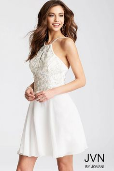 Fit and flare white short dress features chiffon skirt and embellished sleeveless high neck bodice with key hole opening and open back.