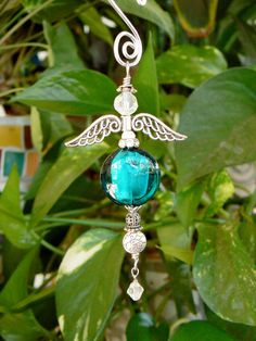 Hand blown teal puffed coin bead hanging angel by LindaGillottiDesigns on Etsy