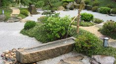 water fountain flowing in a japanese garden design