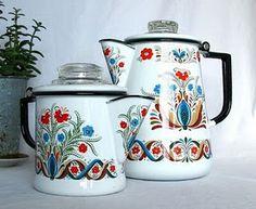 Vintage enamelware coffee percolator featuring Scandinavian folk art
