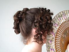 Tutorial for a regency hairstyle that was inspired by Elizabeth Bennet's hair in the 1995 Pride and Prejudice BBC mini series.