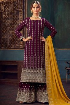 Sway away everyone with your simplicity as you wear this wine maroon georgette sharara suit which makes you appealing This U neck and full sleeve garment accentuated with zari and stone work. Completed with georgette sharara pants in purple color with mustard yellow georgette dupatta. Sharara pants has zari work. Dupatta also embellished in zari work. #shararasuits #malaysia #Indianwear #weddingwear #andaazfashion Sharara Suit, Shalwar Kameez, Pakistani Fashion Party Wear, Indian Fashion, Indian Attire, Indian Wear, Pantalon Cigarette, Georgette Fabric, Costume
