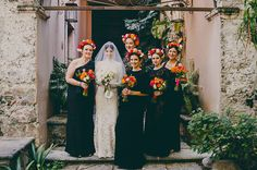 black lace bridesmaids dresses and colourful flower crowns