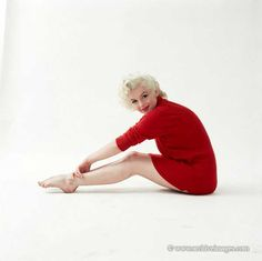 1955 Milton H Greene photograph of Marilyn Monroe wearing only a red sweater.