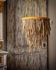 I'm thinking-- take this idea, but make it a WORM chandelier for the haunted house! :: This is a chandelier crafted from driftwood makes a stunning focal point.