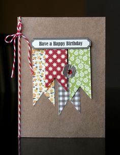 horizontal label with sentiment; large scrap banners; twine on spine; jewel;