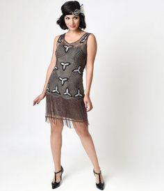 Is flapper your preferred field of study, dears? A tidy and trim taupe mesh flapper dress that can only be found at Uniq...Price - $198.00-Ml90AHxF