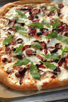 Spicy Sausage, Sun Dried Tomato, and Arugula Pizza | Baker by Nature