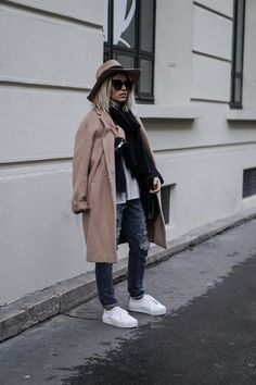 Camille Callen looks chic and stylish in this cute winter outfit consisting of a camel coat, a matching fedora, and a pair of distressed denim jeans. Grab a pair of shades to really get that cool and casual feel! Coat: Promod, T-Shirt: Zara, Jeans: Forever 21, Scarf: Sheinside, Hat: Anine Bing.
