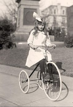 Vintage photo of girl on tricycle