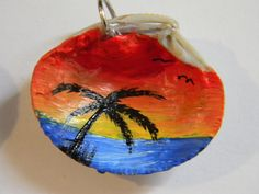 hand painted sea shell necklaces.  www.facebook.com/MickisCustomArt