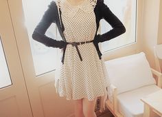 A very cute combination with the black and white polka dot dress, the lace peter pan collar, black cardigan, and the small belt.