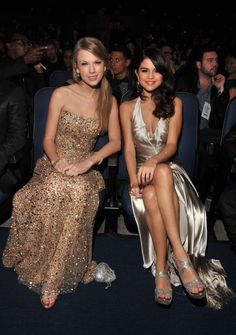 Taylor and Selena!...BFF! Coordinating metallic dresses? Done and done.                  Source: Getty / Lester Cohen/AMA2011