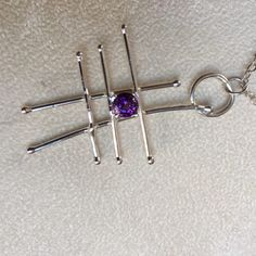 https://dianakirkpatrick.com/product/abstract-silver-and-amethyst-pendant/  Abstract Silver and Amethyst Pendant - handmade abstract silver pendant set with faceted 6mm amethyst stone on silver chain  other gems available www.DianaKirkpatrick.com