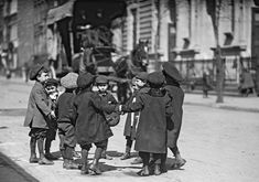 Children playing in street in New York City. From the George Grantham Bain Collection, April 2, 1909.