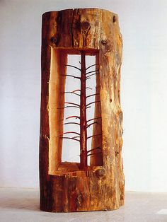 "Giuseppe Penone. Italian sculptor. ""Young trees carved within old trees""."