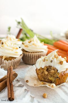 These Spiced Carrot Cake Cupcakes are loaded with fresh shredded carrot, crushed pineapple, and topped with rich cream cheese frosting. | Crumb Kitchen