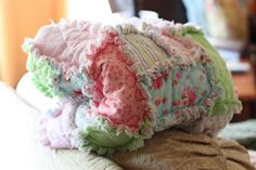 Make It: Rag Quilt for Baby - I Can Teach My Child! {these instructions have rectangles and small squares, too, in the quilt, not just one size of square, which is so pretty}