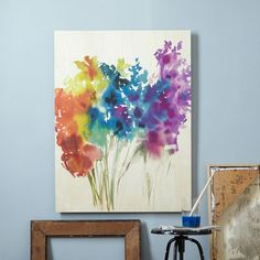 """Floral Watercolor + Birch Wall Art $200  Bold blossoms. Printed on birch wood, our Watercolor Floral + Birch Wall Art features a spray of colorful blossoms that will brighten up even the dreariest of days.  30""""w x 40""""l.  Printed on birch wood."""
