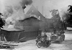 German advance guards and scouts are shown in a Polish town that has been under fire during the Nazi invasion of Poland, September 1939. (AP...