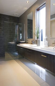 The Best Bathroom Tile Ideas and Design for 2018 - This modern bathroom makes use of a minimal color pattern with white walls and shades of dark grey porcelain wall and also floor ceramic tiles. Ensuite Bathrooms, Bathroom Renos, Bathroom Flooring, Bathroom Ideas, Master Bathroom, Beaumont Tiles, Mid Century Modern Bathroom, Bathroom Styling, Beautiful Bathrooms