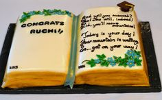 "Open Book Graduation Cake, with a quote from Dr. Seuss book ""Oh, the places you'll go."" Its chocolate cake with chocolate hazelnut mousse filling on one side and yellow cake with strawberry cream cheese filling on the other side."
