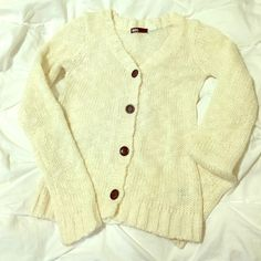 Urban Outfitters BDG white cardigan size XS Urban Outfitters cardigan by BDG. White cardigan with 4 black buttons, size XS. Material: 55% cotton, 40% acrylic, 5% rayon. Worn for one season, in good condition. There was some minor pilling, but I removed the pilling with a machine. Urban Outfitters Sweaters Cardigans