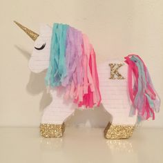 Custom Decorative Monogrammed Unicorn Piñata by darlingdetailsparty on Etsy https://www.etsy.com/listing/486085191/custom-decorative-monogrammed-unicorn