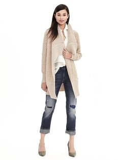 We love this tan drapey long knit cardigan. Layer over your go-to t-shirt and denim combo for a warm winter outfit | Banana Republic