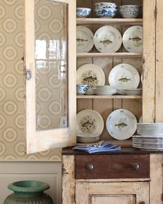 Vintage cupboard, cabinet with dishes. You might like something other than fish plates. :) Photo: Paul Costello