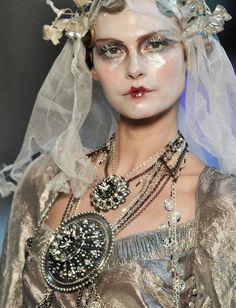 Galliano  love the artful makeup She looks like a wax figure