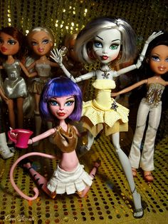 Skull Shores Frankie Stein and CAM Cat (Mittens) Bratz dolls left to right: Dynamite Meygan, Costume Party Pouty Princess Cloe, Magic Hair Raya, Talking Cloe and The Movie Sharidan