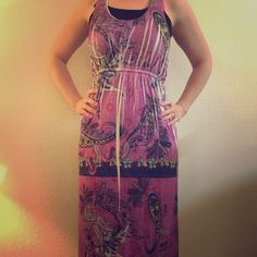 Colorful maxi dress Beautifully detailed maxi dress. Colorful beads around the bottom of the dress. Stretchy and comfortable! Minimal snagging, but there's so much business on the dress that you can hardly tell. I'm 5'6, and it's about .5 in from the ground. Size is large/xlarge, but I think it runs small (therefore my husband doesn't care for the way it fits on me - otherwise I wouldn't be selling it!) Dresses Maxi
