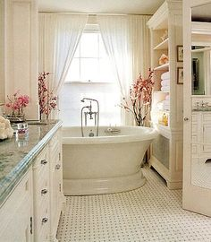 Absolutely love this - bathtub tucked away in its own little nook