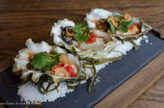Oyster nahm jihm with coriander and crispy shallots.  http://www.asia-bars.com/2014/06/mama-san-kitchen-bar-newly-opened-in-hong-kong/