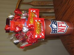 Valentine's Day Candy Bouquet I put together for my nephews. I used a plastic novelty cup, filled with 2 crumpled sheets of tissue paper. Then taped a wooden skewer to each piece of candy. I also stacked 3 heart shaped candies on 1 skewer and added a couple of Lil' Debbie heart brownies ( a fave of theirs). I carefully poked each skewer into the tissue at various heights. You will need to break/cut the ends of the skewers to various heights to arrange a pleasing and balanced bouquet.