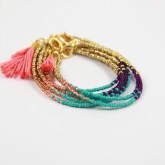 Beaded tassel bracelet in coral, turquoise, purple, & gold  . . . .   ღTrish W ~ http://www.pinterest.com/trishw/  . . . .   #handmade #jewelry #beading