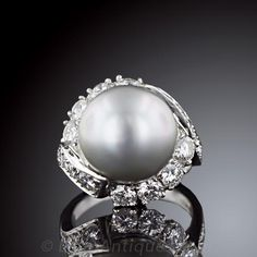 South Sea Pearl Ring 13mm South Sea Pearl is framed within a gorgeous platinum and diamond setting with a total diamond weight of 2.25 cts.