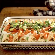 Chicken Enchiladas with green chili and sour cream sauce