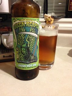 Green Reaper Fresh Hop IPA by Phillips Brewing is dark gold and crispy at 6.5%