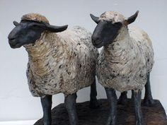 Ceramics by Celia Allen at Studiopottery.co.uk - 2012. Ewes, 20cm high, 25cm long. Raku